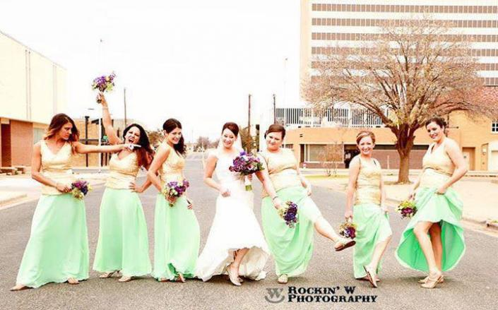 [Image: Your wedding should be fun and memorable! These awesome ladies captured that in this photo showing off their tan and green bridesmaid's dresses.]